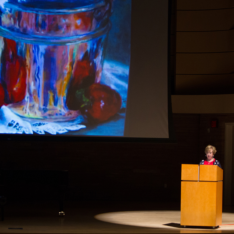 thumbnail image of a presenter on stage at a previous Humanities Festival