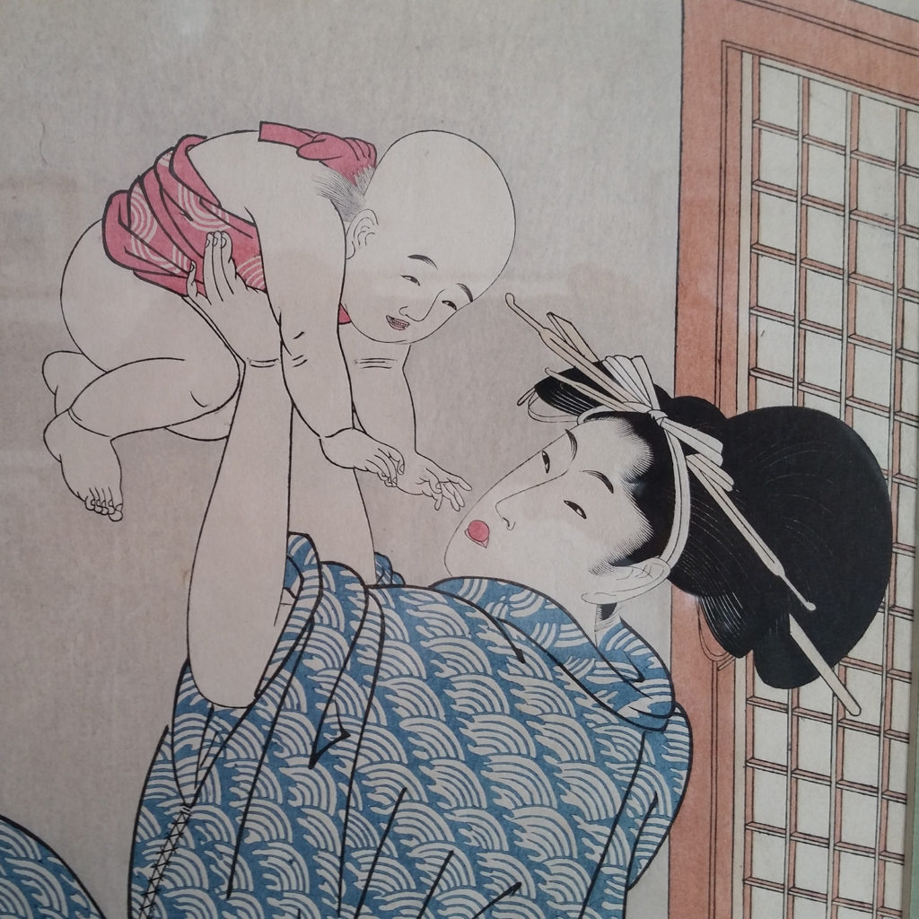 Japanese style drawing of female holding infant