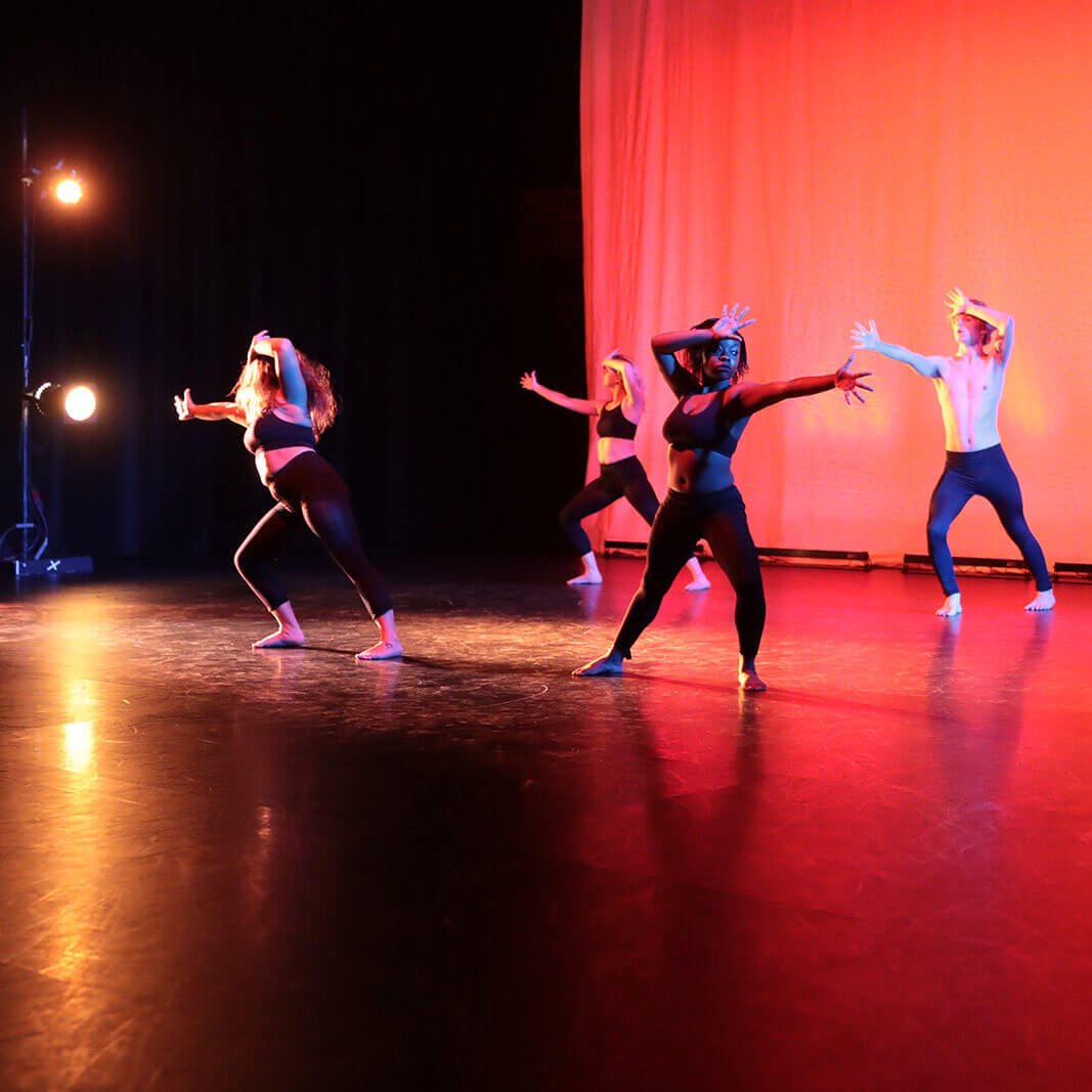 four students, male and female, during a contemporary dance